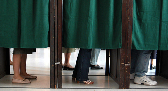 Voters in voting booth. Photo: Colourbox