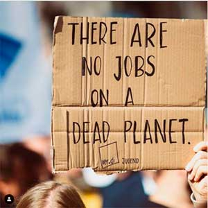 Demonstration poster: 'There are no jobs on a dead planet'